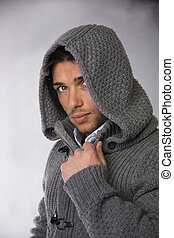 Good looking young man wearing winter hoodie sweater
