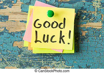 GOOD LUCK text written on sticky note