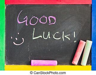Good luck written in chalk on a black board