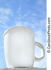 Good Morning Coffee - Coffee cup in front of a blue sky