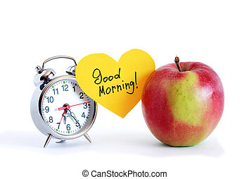 Good Morning inscription on yellow paper heart between apple...