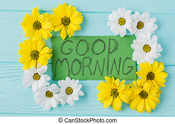 Good morning note and golden-daisy flowers composition. Top ...