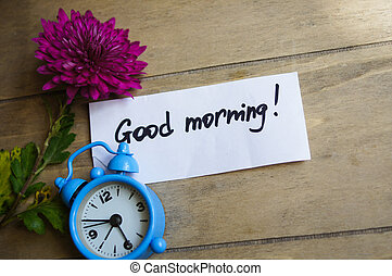 Good morning note and old-styled clock on the wooden ...