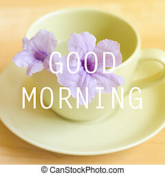 Good morning on blur background of purple flower in cup