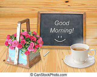 Good morning on chalkboard with coffee cup