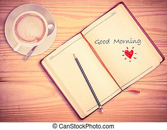 """""""Good morning"""" on notebook , pencil and coffee cup with vintage"""