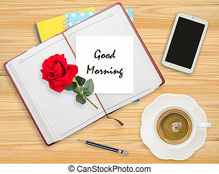 Good morning on paper with red rose and coffee cup