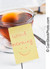 good morning with smile and cup tea.