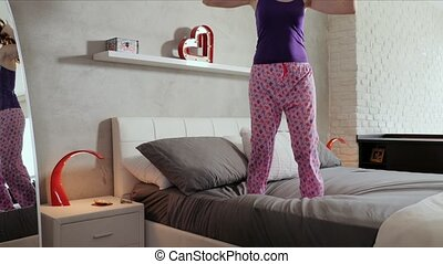 Good News For Happy Young Woman Girl Jumping On Bed - Happy...