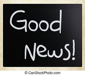 """Good News!"" handwritten with white chalk on a blackboard"