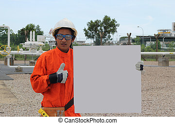 good oil and gas asian worker with blank sign, ready for your text.