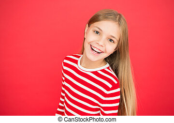 Good parenting. Child care. small girl child. School education. family and love. childrens day. happy little girl on red background. Childhood happiness. copy space. Nice selfie.