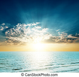 good sunset over blue sea