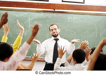 Good teacher in classroom in front of the board