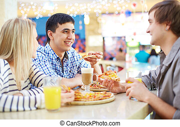 Good time - Image of teenage friends interacting in cafe