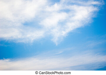 Blue sky with light clouds background