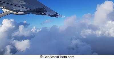 Good weather for air travel theme. Pretty clouds above view