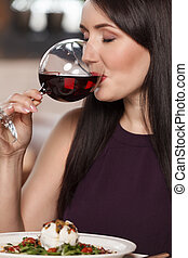 Good wine. Portrait of beautiful mature women drinking wine ...