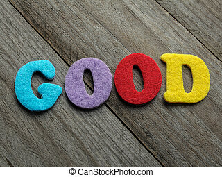 good word on wooden background