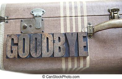 goodbye word on vintage suitcase