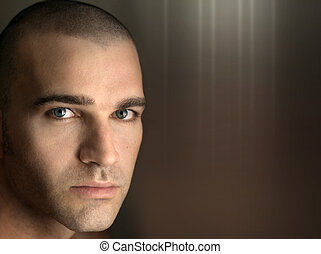 Goodlooking man with shaved head - Close up horizontal...