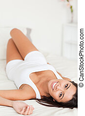 goodlooking woman lying on bed - good looking woman lying on...