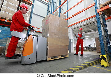 Goods delivery in storehouse - Goods delivery - two workers...