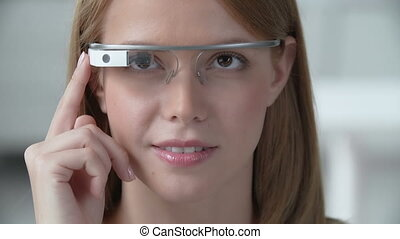 Google Glass Handling Tutorial - Close up of young girl...