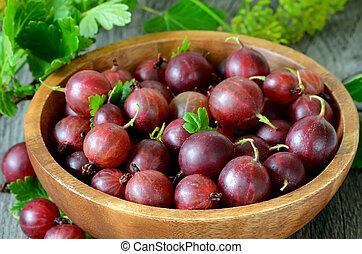 Gooseberries in wooden bowl