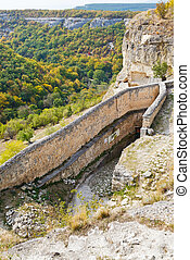 gorge mariam-dere and wall of chufut kale town in Crimean...