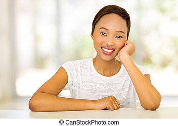 african girl sitting at home