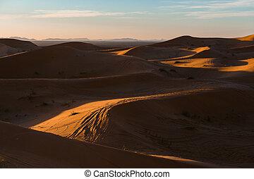 Gorgeous and scenic desert sunset scene above beautiful sand dunes Erg Chebbi, Morocco, Merzouga