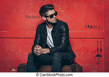 Gorgeous and stylish. Handsome young man in sunglasses...