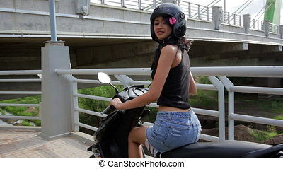 gorgeous asian girl with motorcycle