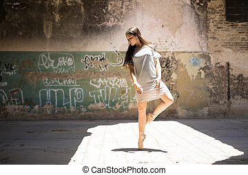 Gorgeous ballet dancer in urban setting