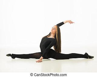 gorgeous ballet dancer performing leg split flexible