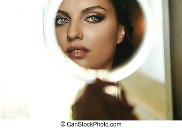 Gorgeous beautiful exotic bride with green eyes mirror reflection face closeup