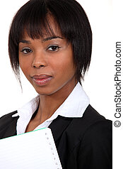 gorgeous black woman holding notebook with thumb index