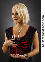 Gorgeous blond drinking red wine
