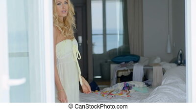 Gorgeous Blond Woman Posing Inside her Room