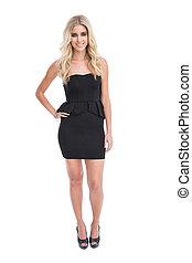 Gorgeous blonde girl in classy black dress posing on white ...