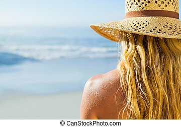 Gorgeous blonde in sunhat on the beach