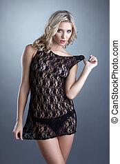 Gorgeous blonde model advertises erotic negligee