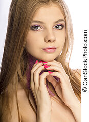 Gorgeous blonde model with sparkling makeup posing at studio over a white background