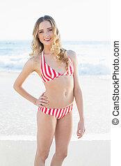 Gorgeous blonde woman posing wearing a bikini