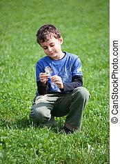 Gorgeous boy in a grass field