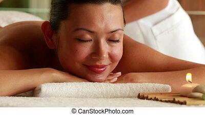 Gorgeous brunette getting a massage