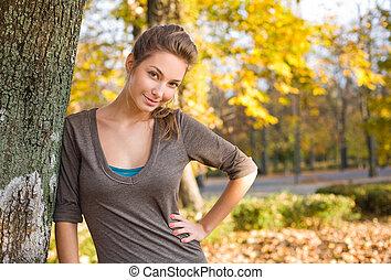 Gorgeous brunette posing in the park.