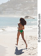 Gorgeous brunette running to the sea