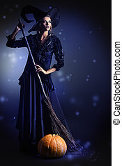 witch - Gorgeous brunette witch with her broom over black...